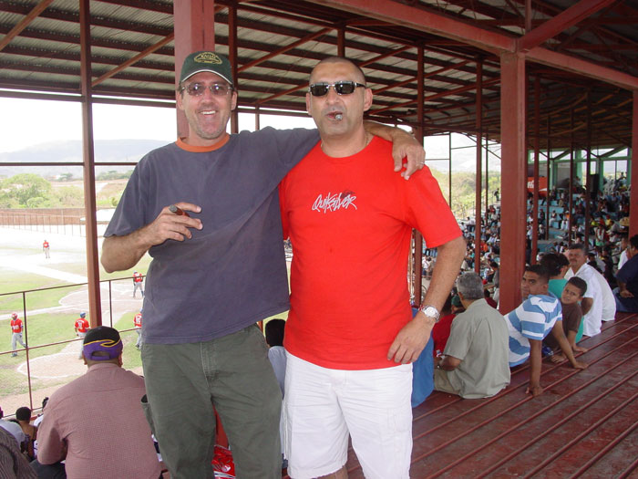 Les Drent and Victor Calvo of Kauai Cigar Company have a cigar and relax at a baseball game.
