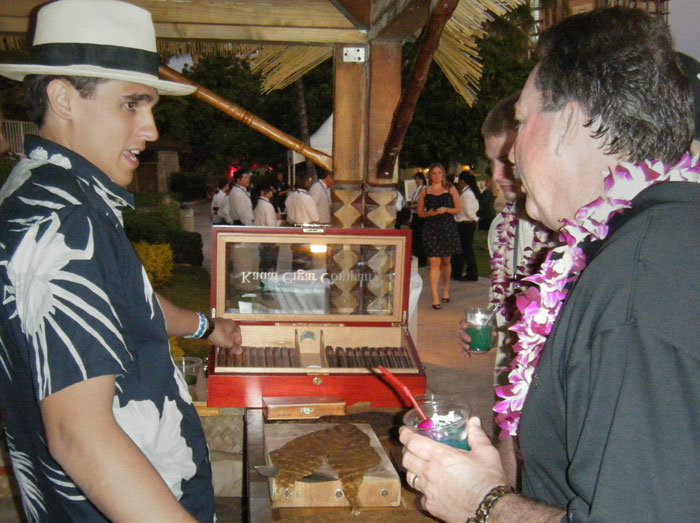 Cigar roller, Tai Erum, explaining the different Island Prince cigars to very interested guests as others arrive.