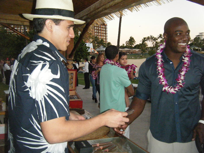 Dallas Cowboys outside linebacker, DeMarcus Ware, having a wonderful time picking out a cigar.